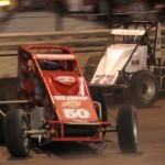 Mike Spencer (50) battles Kyle Larson for the race lead during Sunday's AMSOIL USAC/CRA Sprint Car Series Louie Vermeil Classic event at Calistoga Speedway. (Tom Parker Photo)