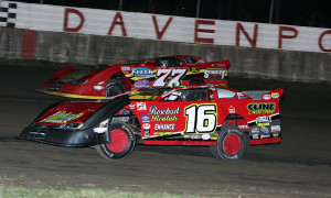 Jeff Aikey (77) runs the high groove through traffic en route to winning a Deery Summer Series late model race at Davenport (Iowa) Speedway in 2013. (Mike Ruefer photo)