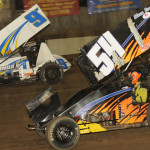 Cap Henry (54) works his way under Jac Haudenschild during Friday's UNOH All Star Circuit of Champions feature at Fremont (Ohio) Speedway. (Julia Johnson Photo)