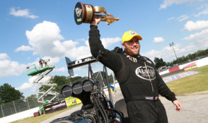 Shawn Langdon celebrates after winning the top fuel portion of the Chevrolet Performance U.S. Nationals on Monday. (Rhonda McCole Photo)