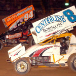 Jack Sodeman Jr. (94) fights off Rod George en route to winning Friday's sprint car feature at Pennsylvania's Lernerville Speedway. (Hein Brothers photo)