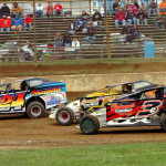 Modifieds racing for position down the frontstretch at Pennsylvania's Mercer Raceway are the 358 Modifieds of Eric Gabany (3e), Gary Smoker and Andy Paden (24). (Hein Brothers photo)