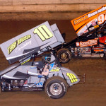 Racing for positions during the Tri-State Championship at Pittsburgh's Pennsylvania Motor Speedway are sprint car drivers Carl Bowser (10) and Jack Sodeman Jr. (Hein Brothers photo)