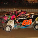 Battling it out for the lead position during the 358 modified feature at Mercer Raceway are Frankie Guidace (1g) and J.R. McGinley (66). Guidace won his fourth feature of the season. (Hein Brothers photo)