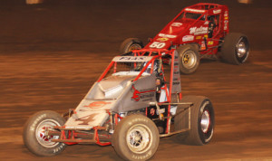 Nic Faas (4) battles his way by Mike Spencer to win Saturday's AMSOIL USAC-CRA Sprint Car Series race at Perris (Calif.) Auto Speedway. (Doug Allen Photo)