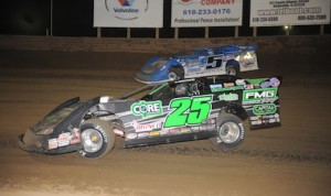 Brandon Sheppard (5) races around Shane Clanton en route to winning Friday's World of Outlaws Late Model Series race at Belle-Clair Speedway. (Don Figler photo)