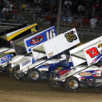 The parade lap for the Jerry Richert Memorial sprint car race at Cedar Lake Speedway in Wisconsin. The race was won by Mark Dobmeier (13). (Doug Johnson photo)