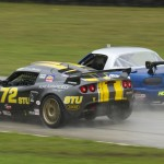 Elivan Goulart (72) fights of Marc Hoover to win the STU national championship at Road America. (Shawn Mueller photo)