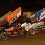 """Jack Sodeman Jr. (94) and Eric """"Turkey"""" Williams battle for the lead during the 25-lap sprint car feature at Pennsylvania's Mercer Raceway Park. Sodeman won the race and the track championship. (Hein Brothers photo)"""