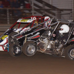 Coming to the checkered flag, Michael Brenner (24) hooked onto winner Cory Angle in the senior sprint class at Indiana's U.S. 24 Speedway. (Gary Gasper photo)