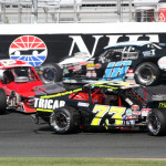 Richie Pallai Jr. (39) and Cole Powell (73) get turned around as Ken Heagy sneaks by during Saturday's NASCAR Whelen Modified Tour race at New Hampshire Motor Speedway. (Dick Ayers Photo)