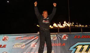 Darrell Lanigan celebrates after winning his World 100 preliminary race Friday at Eldora Speedway. (Mike Ruefer Photo)