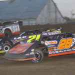 Eddie Carrier Jr. (28), Billy Moyer (21) and Jon Henry during Friday's Lucas Oil Late Model Dirt Series feature at Attica (Ohio) Raceway Park. (Action Photo)