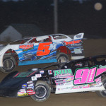 Rusty Schlenk (91) and Ryan Markham during Friday's Lucas Oil Late Model Dirt Series event at Attica (Ohio) Raceway Park. (Action Photo)