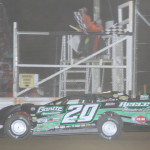 Jimmy Owens crosses the finish line to win Friday's Lucas Oil Late Model Dirt Series race at Attica (Ohio) Raceway Park. (Action Photo)