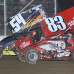 Tim Shaffer (83) battles below Cap Henry during Saturday's UNOH All Star Circuit of Champions race at Attica (Ohio) Raceway Park. (Action Photo)