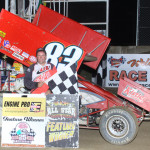 Tim Shaffer stands in victory lane after winning Saturday's UNOH All Star Circuit of Champions feature at Attica (Ohio) Raceway Park. (Action Photo)