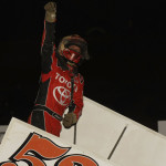 Christopher Bell celebrates his Midwest Open Wheel Ass'n victory Saturday at Spoon River Speedway. (Mark Funderburk Photo)