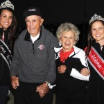 Earl and Berneice Baltes are joined by the Eldora Speedway trophy queens during the 4-Crown Nationals. (Frank Smith photo)