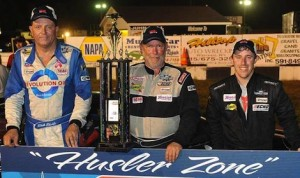 ARCA Midwest Tour winner Steve Holzhausen (center) shares the podium with Rich Bickle and his son Skylar Holzhausen.