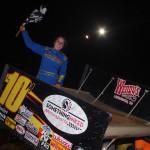 Morgan Turpen celebrates her USCS sprint car triumph at Cleveland (Tenn.) Speedway. (Chris Seelman photo)