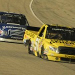 Kyle Busch (51) battles Brad Keselowski for the race lead late in Friday's NASCAR Camping World Truck Series race at Chicagoland Speedway. (Bradley Rahm Photo)