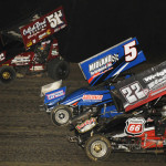 Ryan Jamison (51), Shawn Whiting (5) and Kyle Peterson fight for track position during the MOWA sprint car feature at 34 Raceway in West Burlington, Iowa. (Mark Funderburk photo)