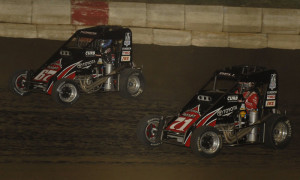 Tanner Thorson (67) battles Christopher Bell during a 2013 Lucas Oil POWRi National Midget Series race at Jacksonville (Ill.) Speedway. (Mark Funderburk Photo)