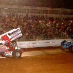 Danny Dietrich (48) takes the white flag ahead of eventual race winner Don Kreitz Jr. during Friday's World of Outlaws STP Sprint Car Series race at Williams Grove Speedway. (Hein Brothers Photo)