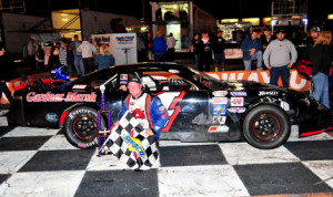 Jay Fogleman stands in victory lane after winning Saturday's PASS South late-model event at Orange County Speedway. (Ken MacIsaac Photo)