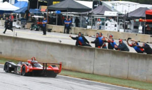Ryan Booth's crew cheers him on as he takes the checkered flag to win Friday's Cooper Tires Prototype Lites finale at Road Atlanta. (IMSA Photo)