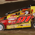 Billy Decker (91) on his way to victory in the King of the Can big-block modified race Friday at Penn-Can Speedway.