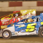 Joey Grammes (5) works under Billy Decker during the King of the Can big-block modified race at Penn-Can Speedway Friday evening.