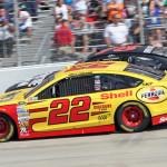 Joey Logano (22) battles Kurt Busch during Sunday's NASCAR Sprint Cup Series race at Dover Int'l Speedway. (HHP/Alan Marler Photo)
