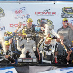 Jimmie Johnson's team celebrates after winning Sunday at Dover (Del.) Int'l Speedway. (HHP/Alan Marler Photo)