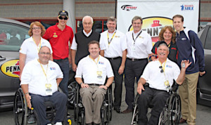 Roger Penske, Joey Logano and Brad Keselowski were on hand when Pennzoil donated three retrofitted Toyota vehicles to three deserving veterans as part of the continued relationship between Pennzoil and Paralyzed Veterans of America. (HHP/Alan Marler Photo)