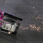 Elliott Sadler's damaged Toyota slides down the track after a crash on Friday during the NASCAR Nationwide Series race at Charlotte Motor Speedway. (HHP/Brian Lawdermilk Photo)