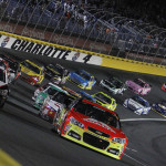 Jeff Gordon (24) and Kevin Harvick (29) lead the NASCAR Sprint Cup Series field to the start of the 2013 Bank of America 500 at Charlotte Motor Speedway. (HHP/Brian Lawdermilk Photo)
