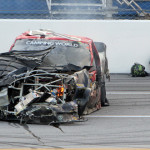 Kyle Busch sits beside his damaged Toyota after a crash on the final lap of Saturday's NASCAR Camping World Truck Series race at Talladega Superspeedway. (HHP/Alan Marler Photo)