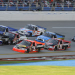 Parker Kligerman (20) leads a pack of trucks during the Fred's 250 NASCAR Camping World Truck Series race at Talladega (Ala.) Superspeedway. (HHP/Rusty Jarrett Photo)