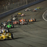 Ryan Hunter-Reay leads the IZOD IndyCar Series field into turn one during the MAVTV 500 season finale at Auto Club Speedway on Saturday night. (IndyCar Photo)