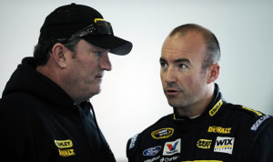 Todd Parrott (left), seen here talking with Richard Petty Motorsports driver Marcos Ambrose, has been suspended for violating NASCAR's substance abuse policy. (NASCAR Photo)