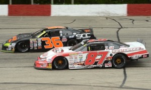 Nathan Haseleu (87) races under Dan Fredrickson Sunday at Lacrosse Fairgrounds Speedway in Wisconsin. (Doug Hornickel photo)