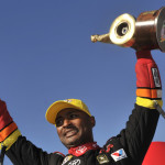 Antron Brown celebrates after winning the NHRA Top Fuel class Wally at Gateway Motorsports Park on Sunday. (NHRA Photo)