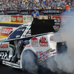 John Force performs a burnout prior to his final round victory Sunday at Gateway Motorsports Park. (NHRA Photo)