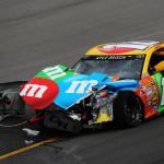 Kyle Busch exits his damaged Toyota after a crash Sunday at Kansas Speedway. (NASCAR Photo)
