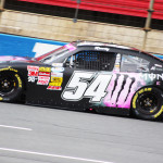 Kyle Busch celebrates in victory lane with this special Monster Energy scheme at Charlotte Motor Speedway last Friday. He also donated all of his race winnings to a breast cancer charity. (Adam Fenwick Photo)