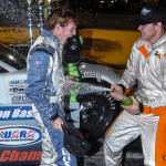 Ronnie Bassett Jr. (right) sprays his younger brother Dillon Bassett after Dillon clinched the 2013 UARA-STARS Late Model Series championship on Saturday at Anderson (S.C.) Motor Speedway. (Drew Hierwarter Photo)