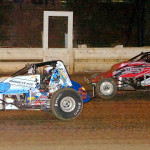 Kirk Jeffries (59) holds off hard charger Brandon Matus during the BOSS non-winged sprint car race at Pittsburgh's Pennsylvania Motor Speedway. (Hein Brothers photo)