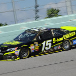 Michael Waltrip Racing's Clint Bowyer drives during a driver test at Homestead-Miami Speedway in Homestead, Florida.